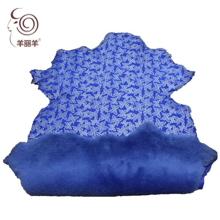【羊丽羊】蓝色绒面蝴蝶印花皮毛一体